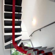 Escalier double quarts tournant à limon central sur-mesure